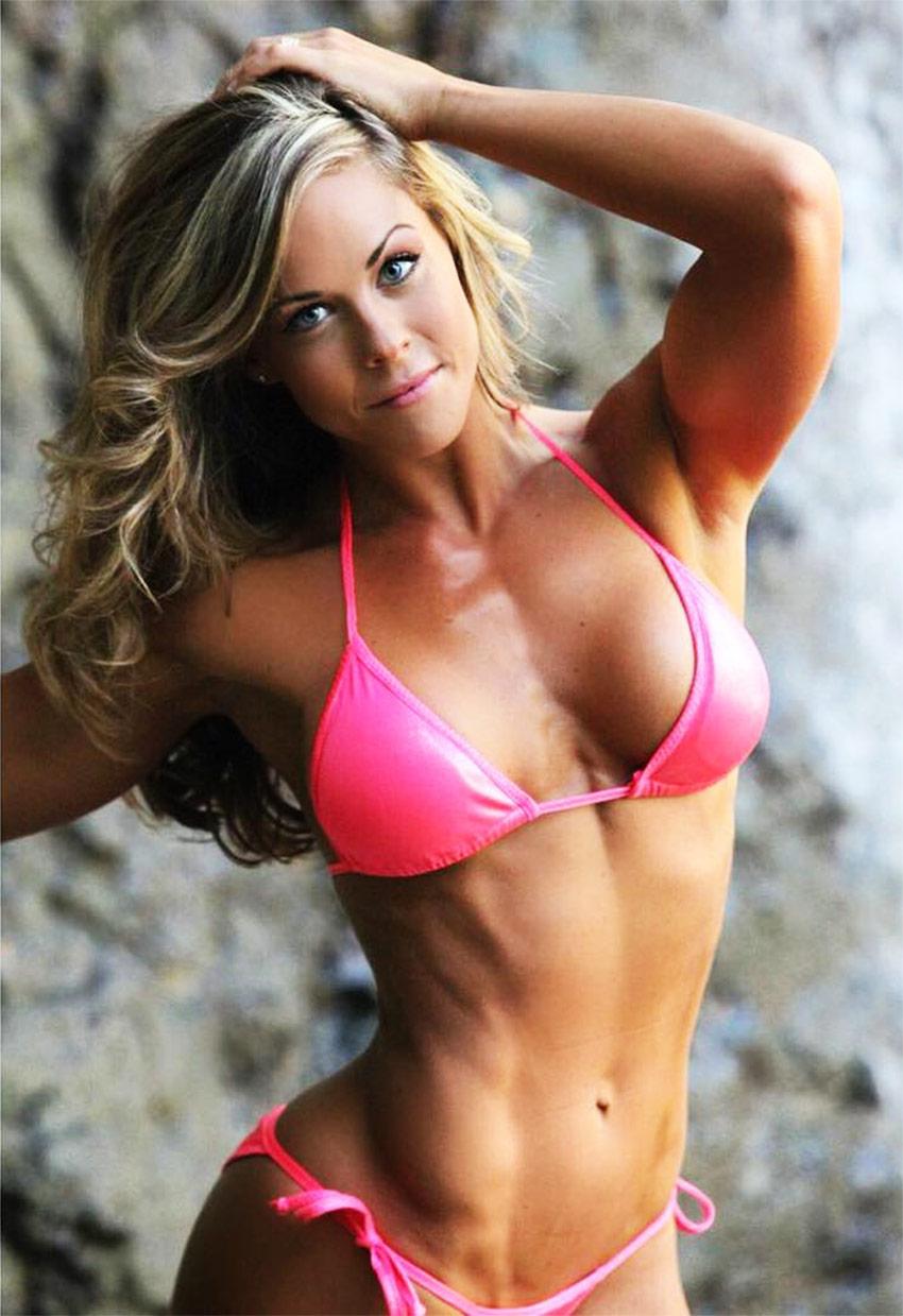 Sami Bossert posing for a professional photoshoot in a bikini