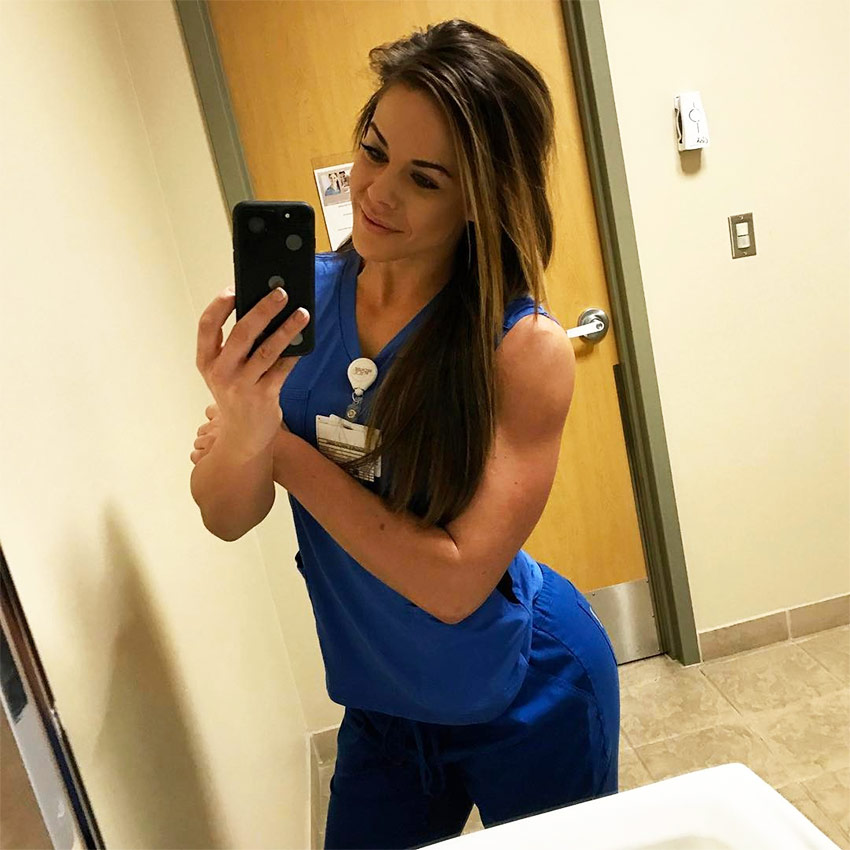 Sami posing in her nurse outfit at work.