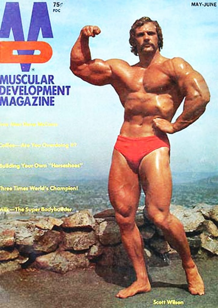 Scott Wilson posing, tensing his arms on the cover of an old magazine in the 1970-1980's.