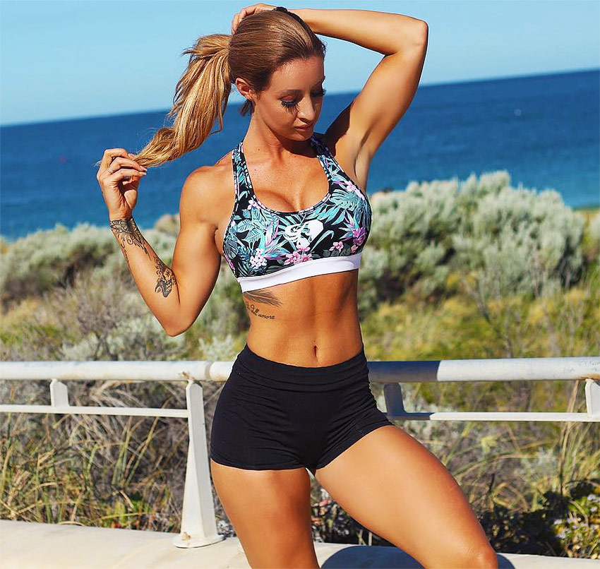 Steph Pacca in a photo of her running into the sunset in sportswear, showing her muscular definition in her arms and abs.