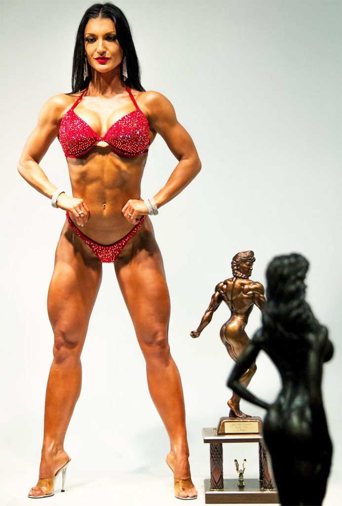 Valerija Slapnik posing in her bikini next to her big trophy.