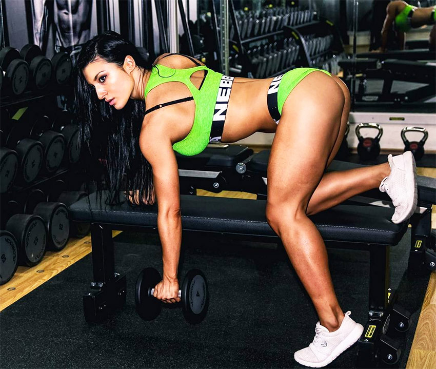 Valerija-Slapnik-performing-dumbbell-raises-in-the-gym
