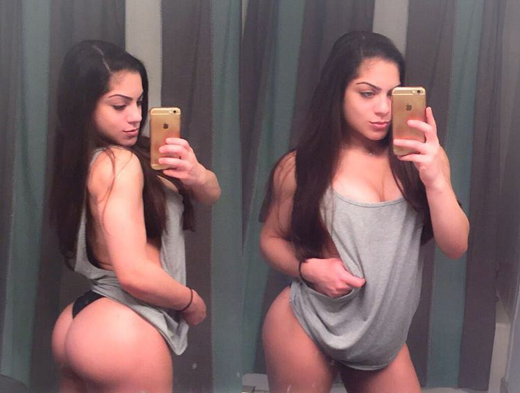 Ariel Khadr selfie in the mirror, showing her chest and glutes