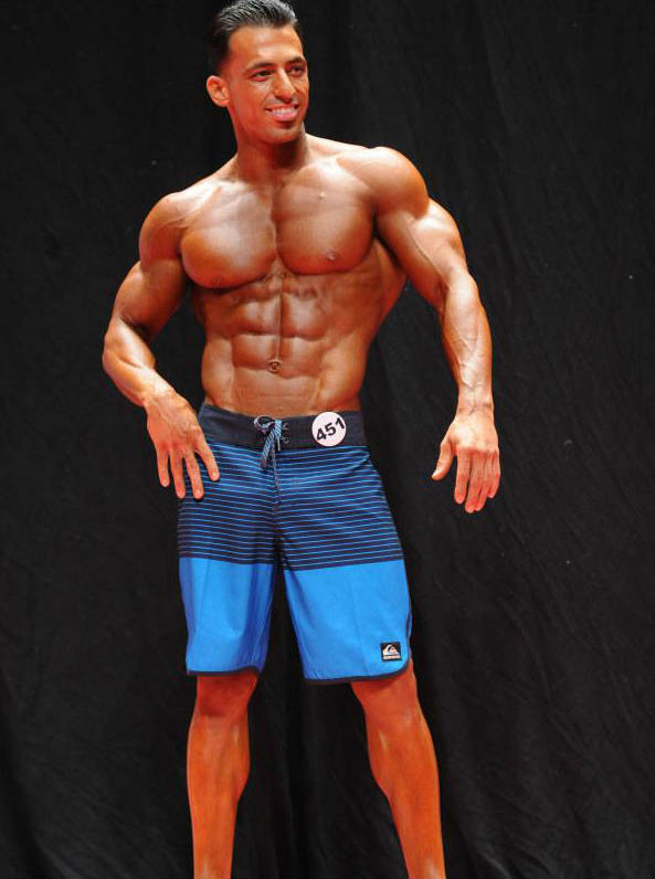 arya saffaie in blue shorts competing