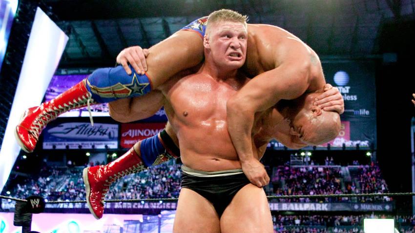 brock lesnar lifting a man over his shoulders
