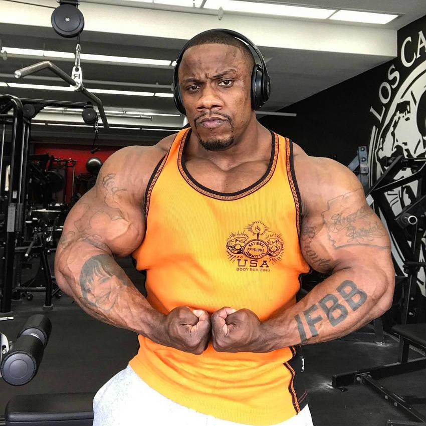charles griffen tensing his biceps