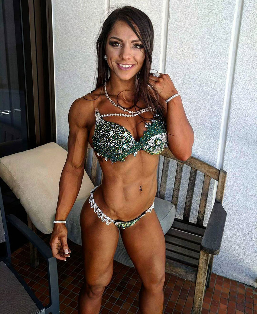 Christina Eleni wearing her bikini competition outfit smiling looking happy and muscular