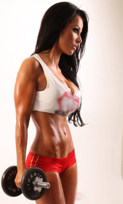 Christina Halkiopoulos holding a dumbbell in her right hand while showing her toned body