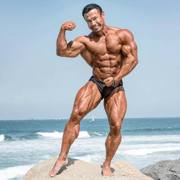 Danny Hester posing on the beach in California