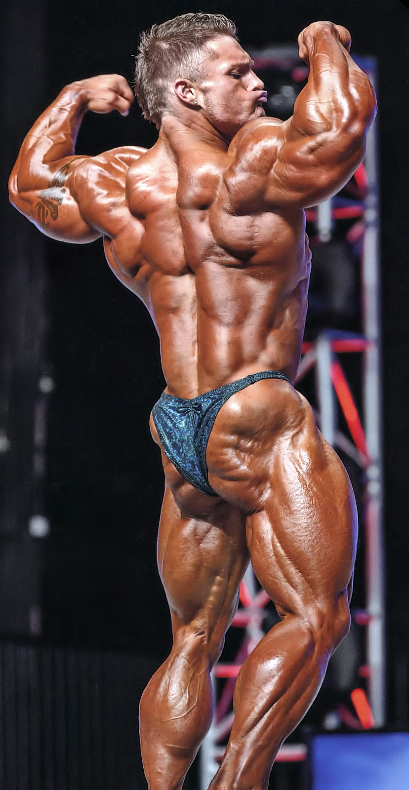 James Flex Lewis performing back double biceps pose while being on a stage