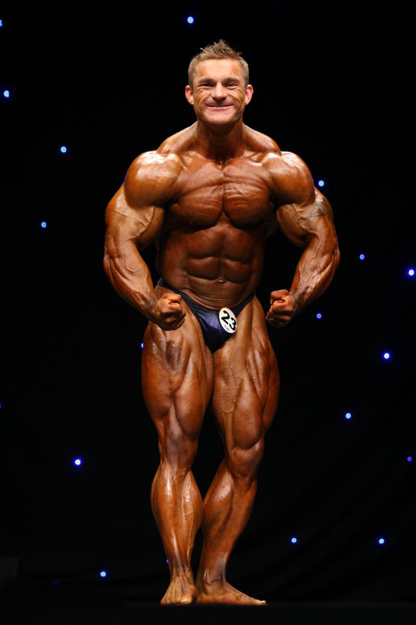 James Flex Lewis in a most muscular pose on the stage