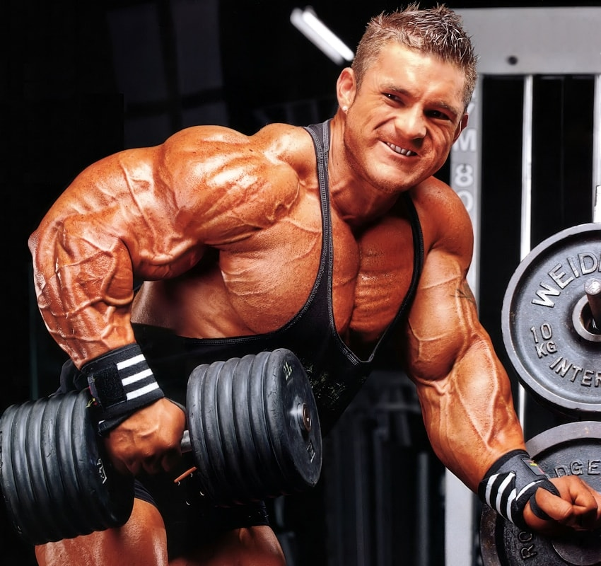 Profile picture of James Flex Lewis, doing dumbbell bent over rows for a photoshoot