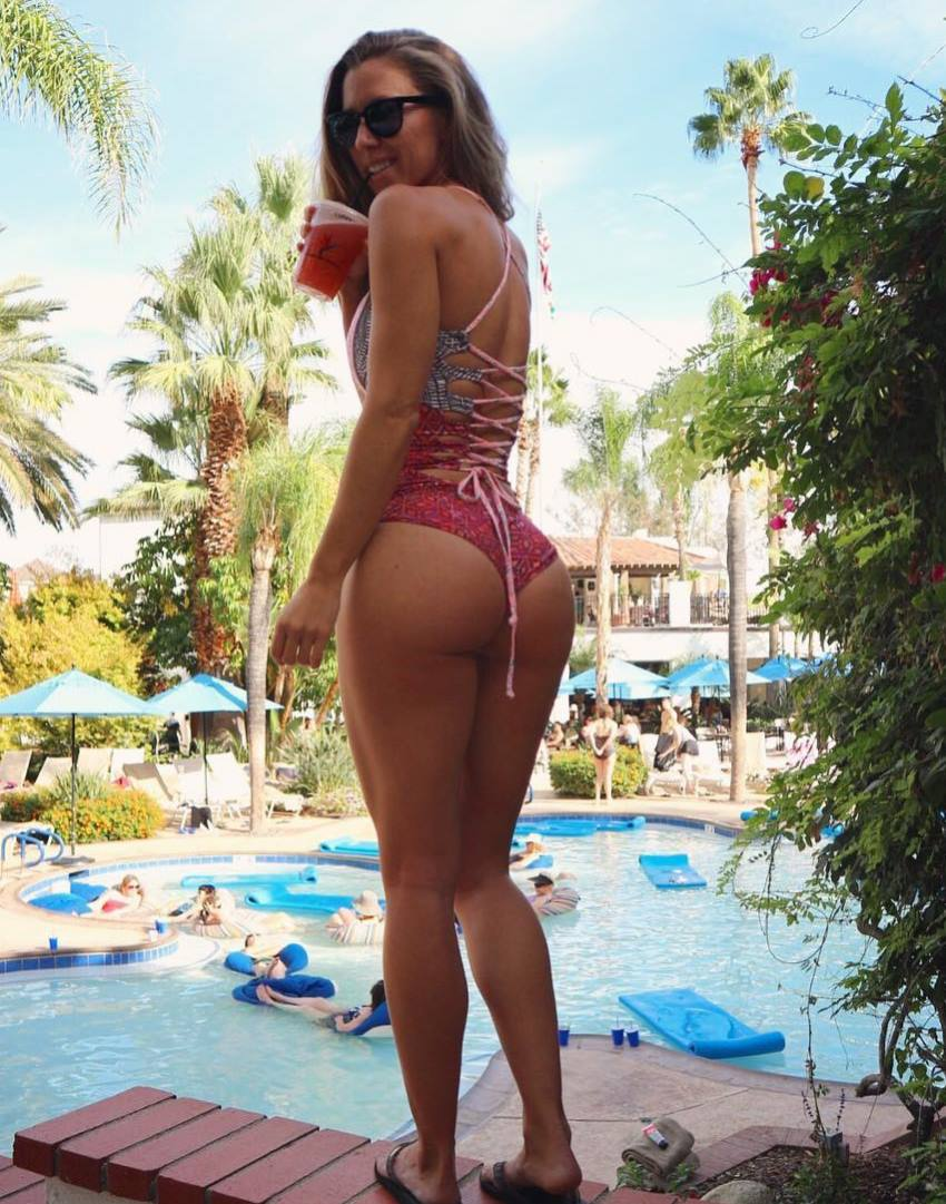 Jessie Delgado at a pool party, showing her legs and glutes