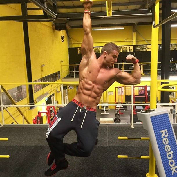 josef rakich hanging from a bar in the gym