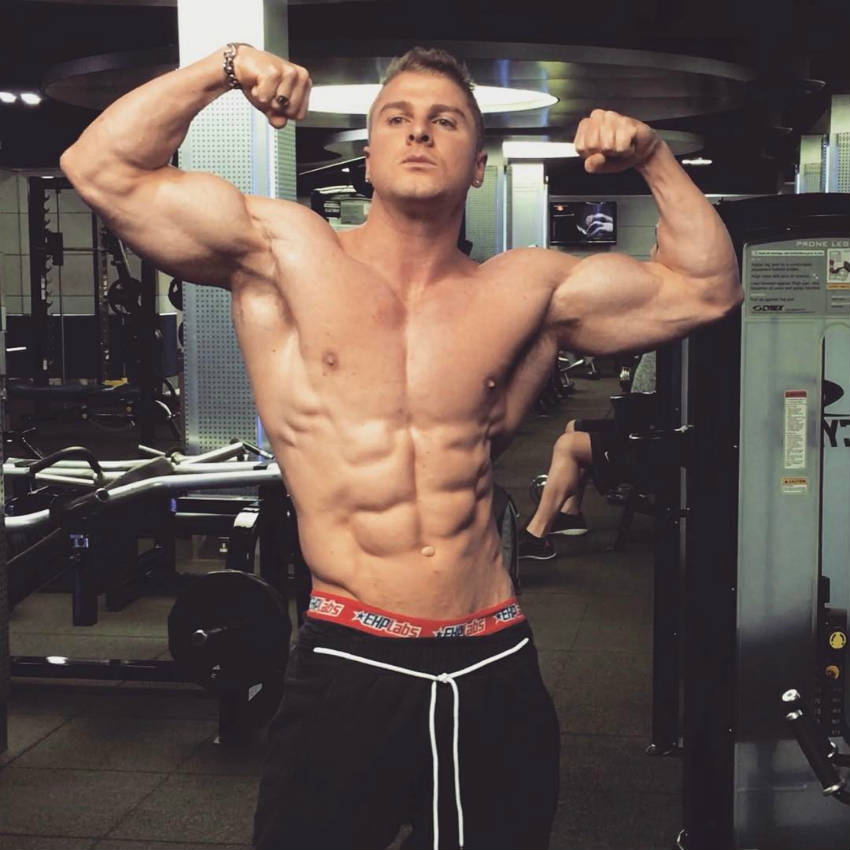 josef rakich posing in the gym