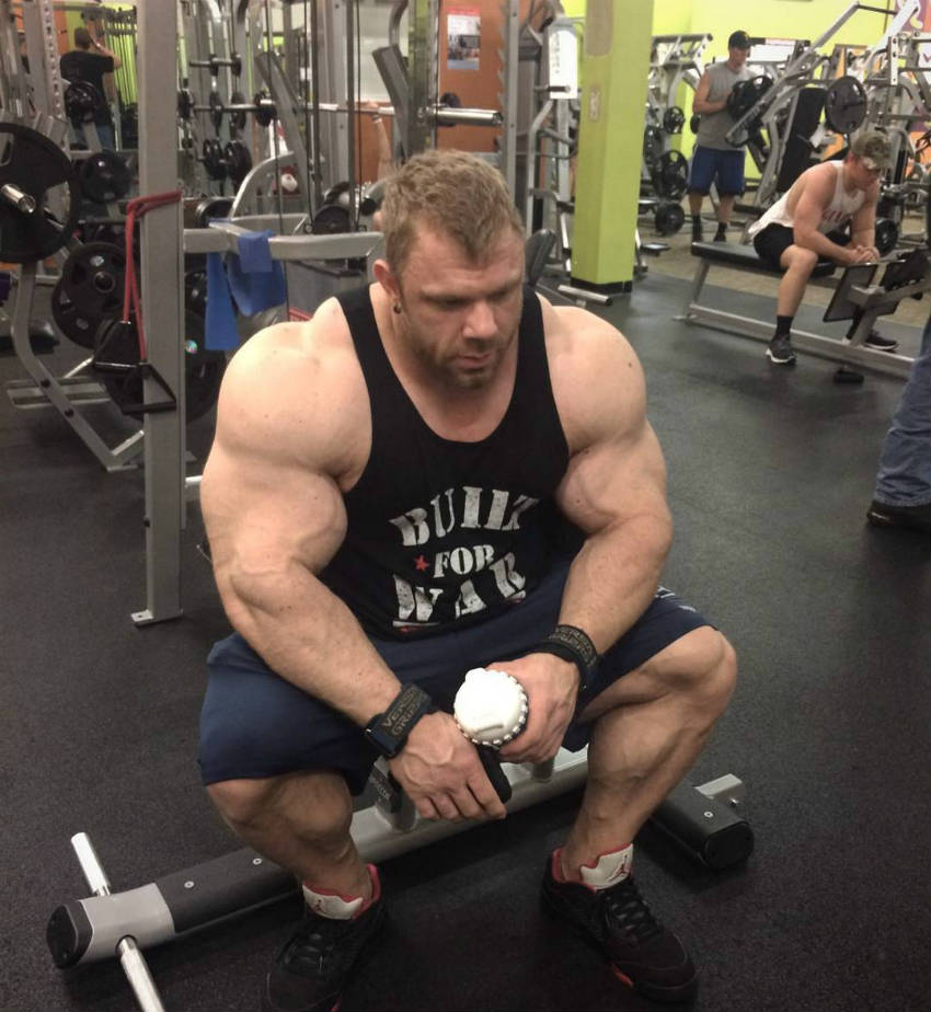 justin compton sitting tired in the gym