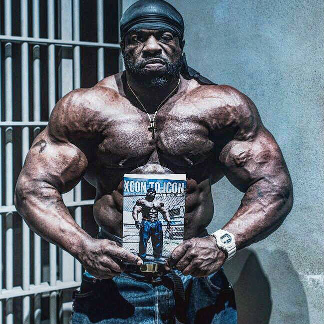 kali muscle posing with his book