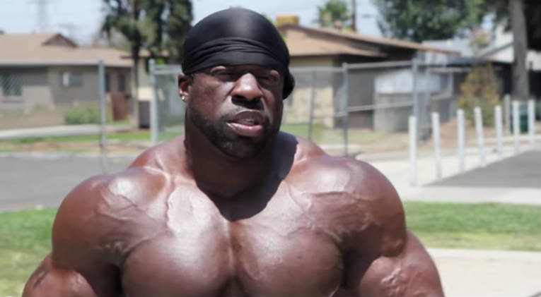 kali muscle standing in his neighborhood