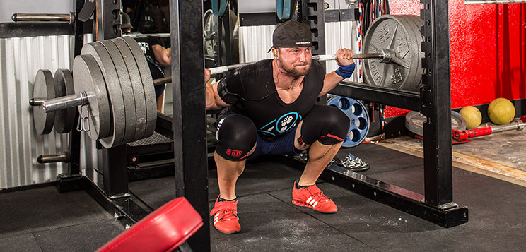 Layne Norton doing heavy squats