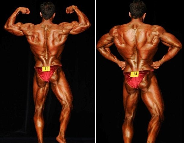 Layne Norton posing on the stage, showing his conditioned and tanned back and legs to the audience and judges