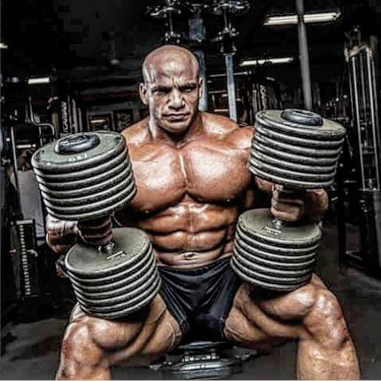mamdouh with large dumbbells