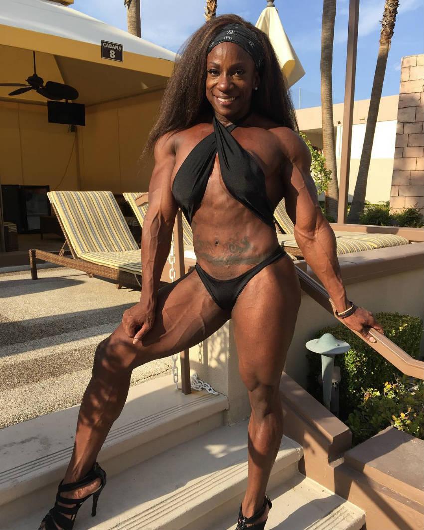 margie v martin standing on steps in black bikini