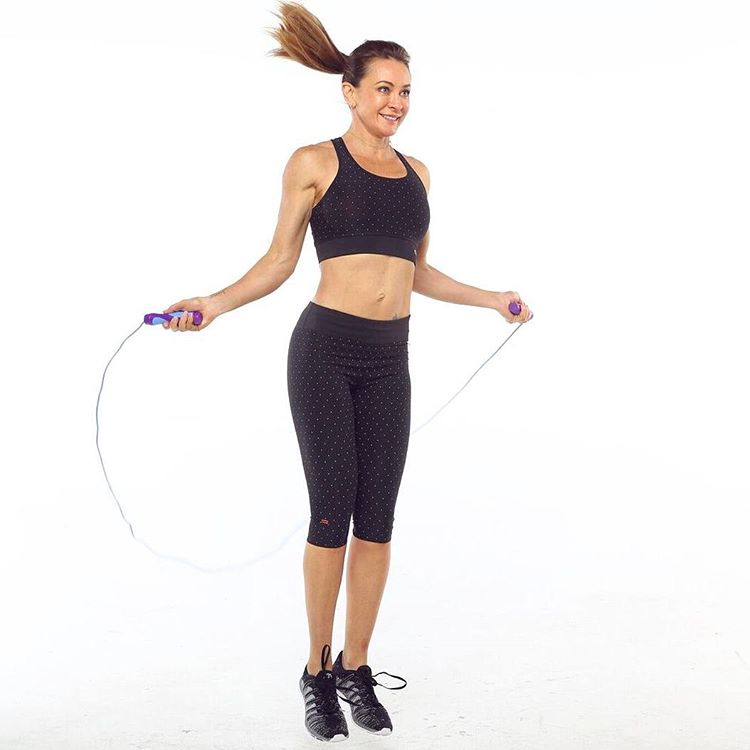 Michelle Bridges having a rope skipping workout, performing single unders