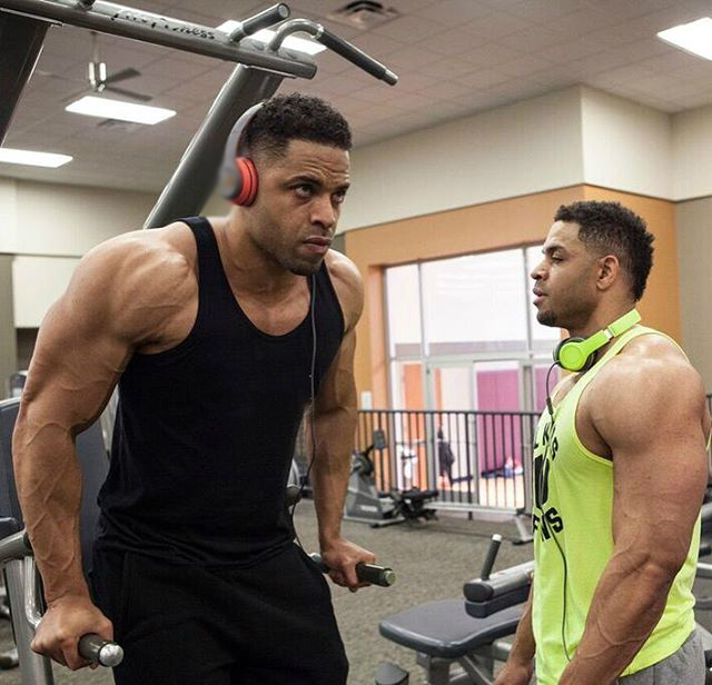 One of the Hodgetwins doing dips while the other is resting between his sets