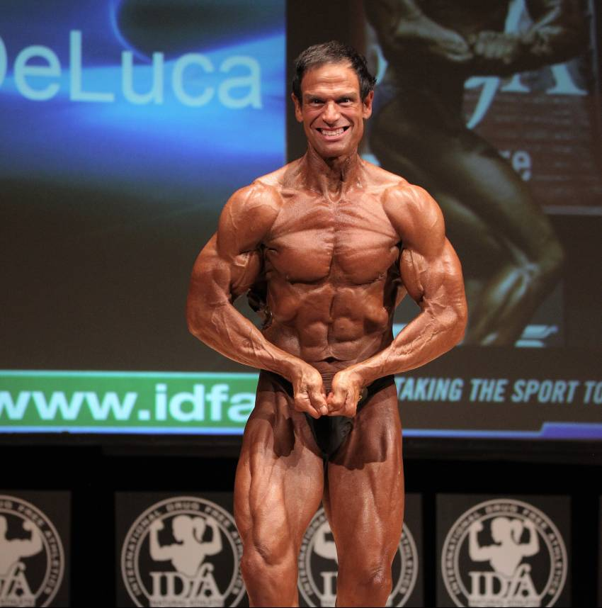 rob deluca flexing most muscular on the bodybuilding stage, looking ripped and muscular