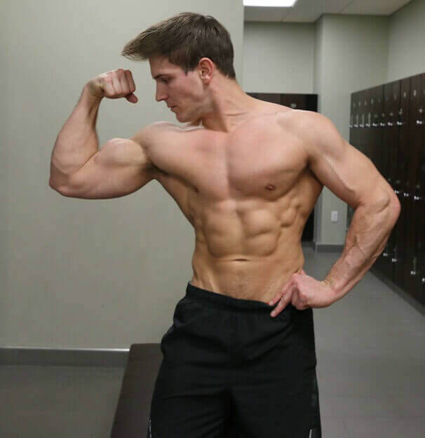 scott herman tensing his bicep
