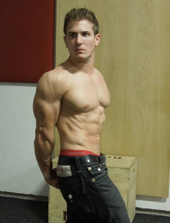 scott herman wearing jeans and flexing his triceps