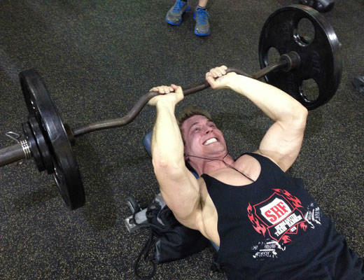scott herman working out with barbell