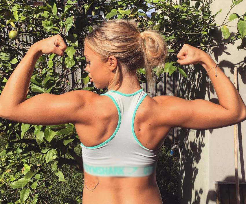 Tammy Hembrow in a back double biceps pose