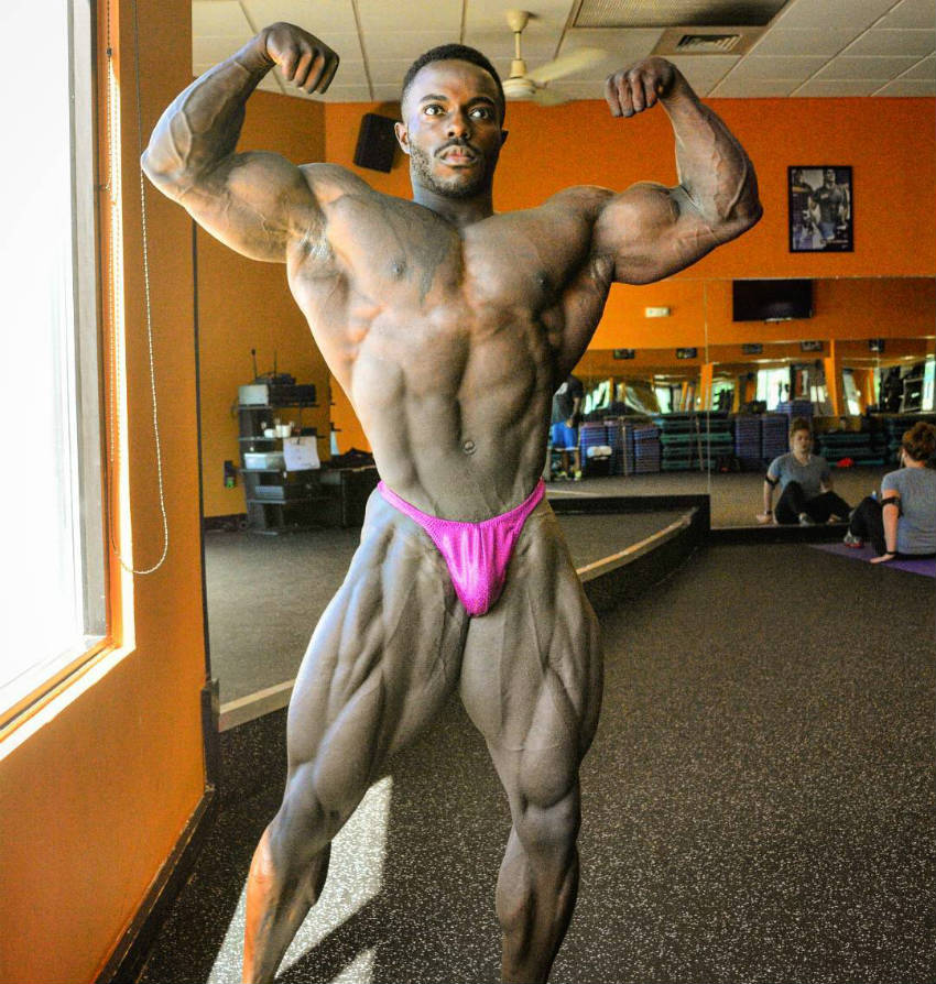 terrence ruffin posing in gym in pink trunks
