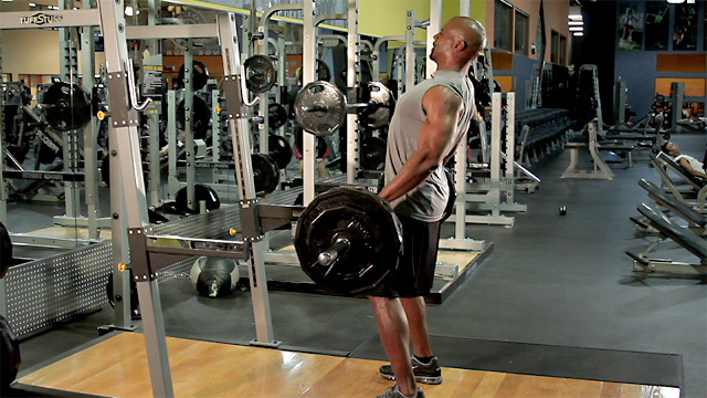 Terry Crews performing deadlifts in a gym