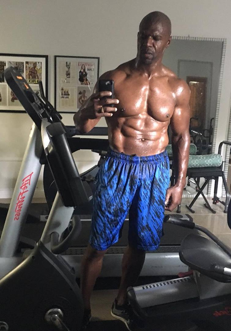 Terry Crews selfie on a treadmill machine, showing his seaty body after a long and intense cardio session