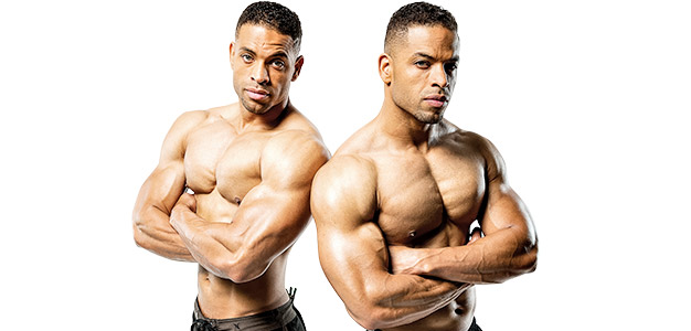 The Hodgetwins doing a professional photoshoot, where they are looking at the camera with a serious expression on their faces, while also showing their ripped upper bodies