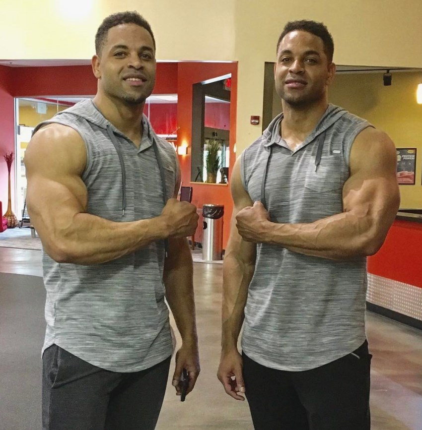 The Hodgetwins flexing their arms at the camera