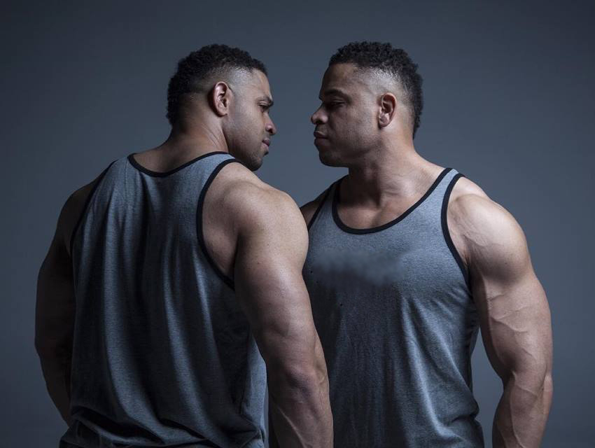 The Hodgetwins looking extremely seriously each other directly in the eyes