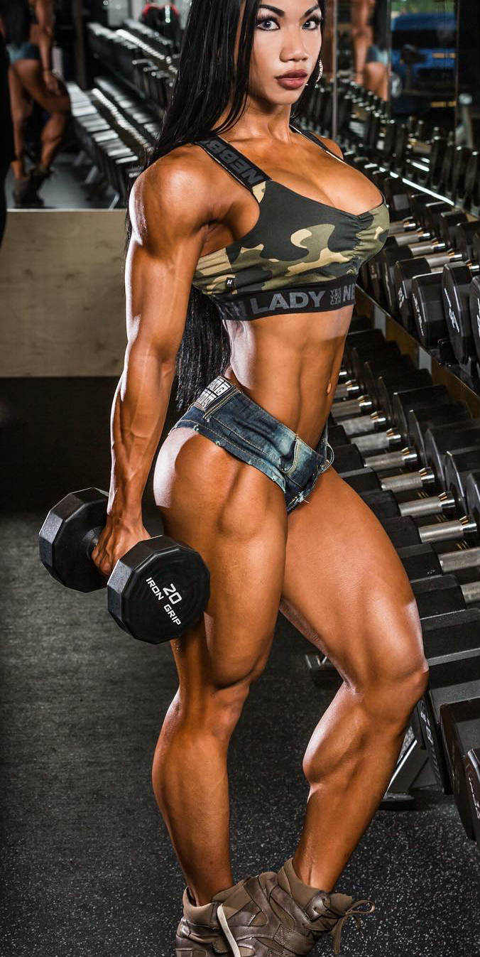 tina nguyen standing with dumbell in hand