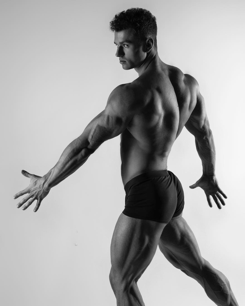 Vlad Lapshin practicing posing while being shirtless, revealing his muscular and lean body