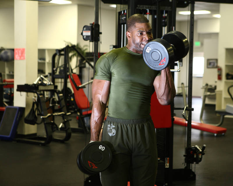 xavisus gayden completing a bicep curl in his marine training clothes