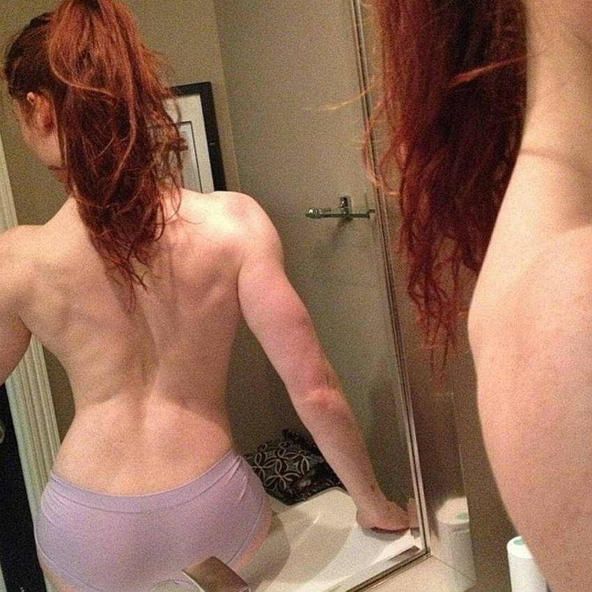 Abby Pollock showing her toned back and triceps
