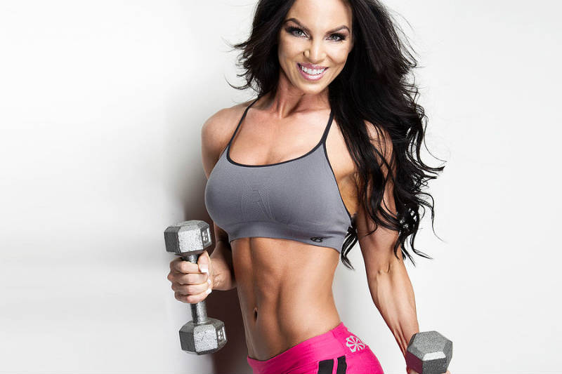 Amber Dawn Orton, showing her toned abs and arms while holding dumbbells