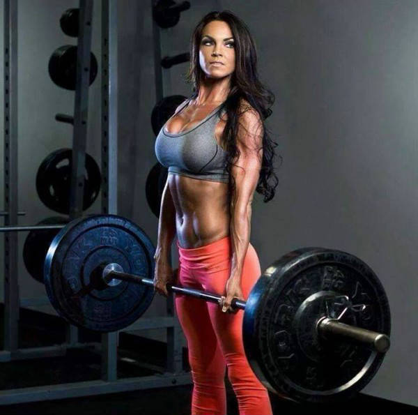 Amber Dawn Orton holding a barbell, showing her toned abs and arms