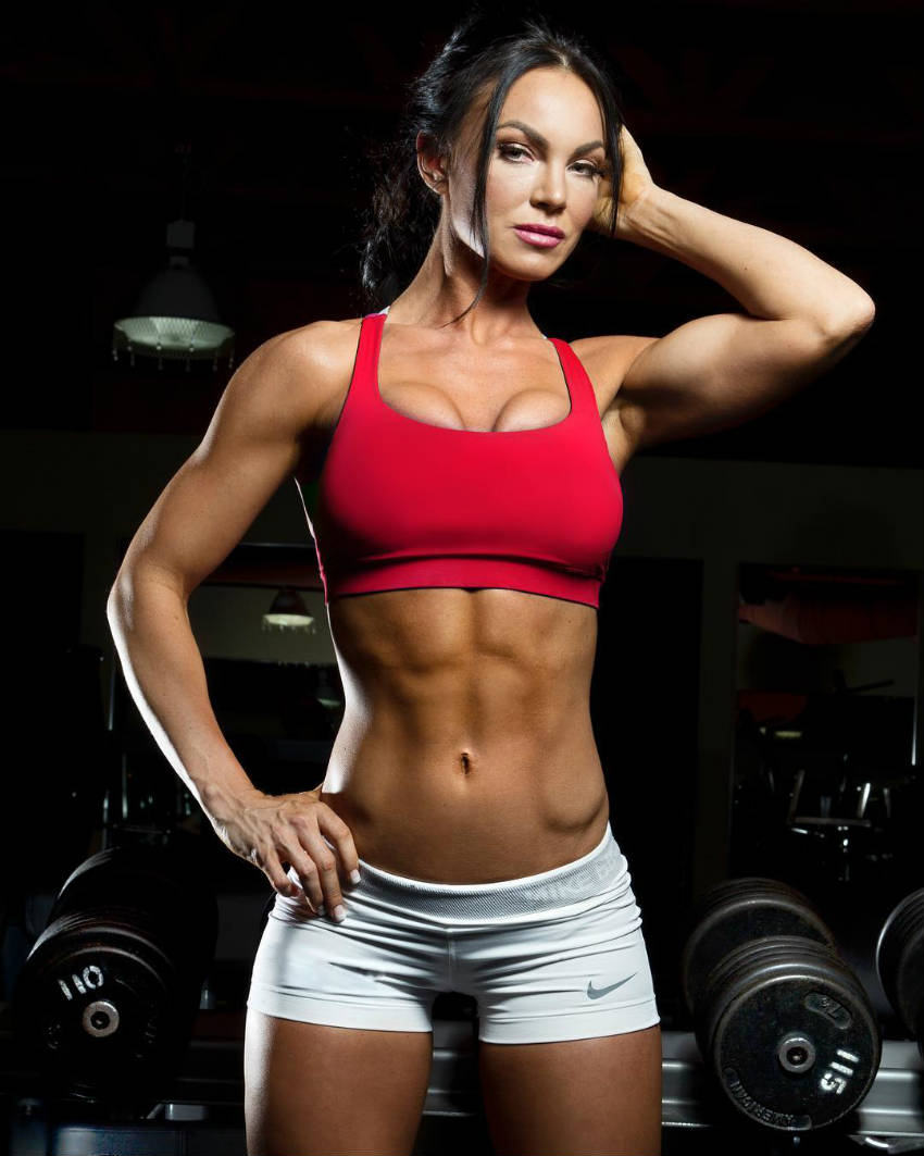 Amber Dawn Orton showing her toned abs, arm and legs