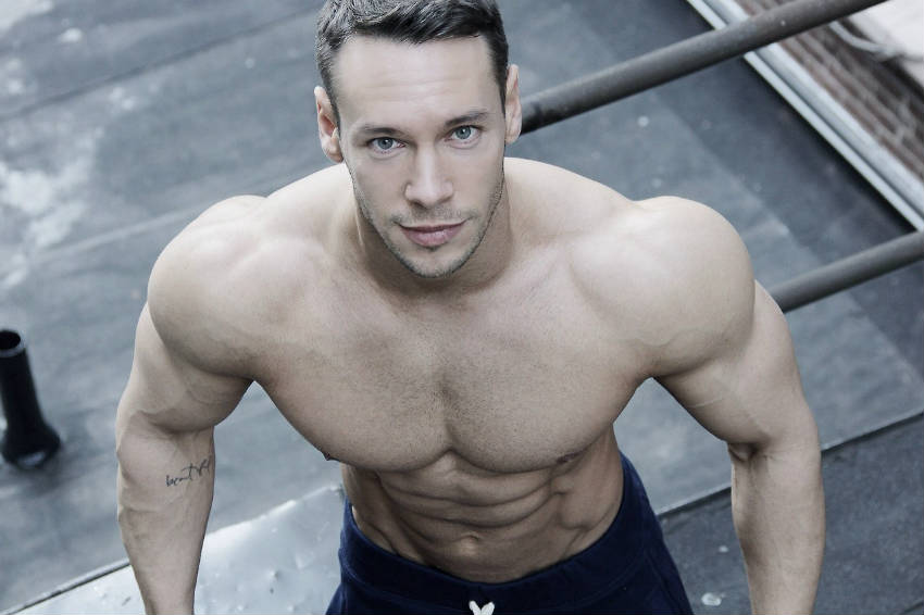 Anton Antipov from above with his delts, traps and abs visible