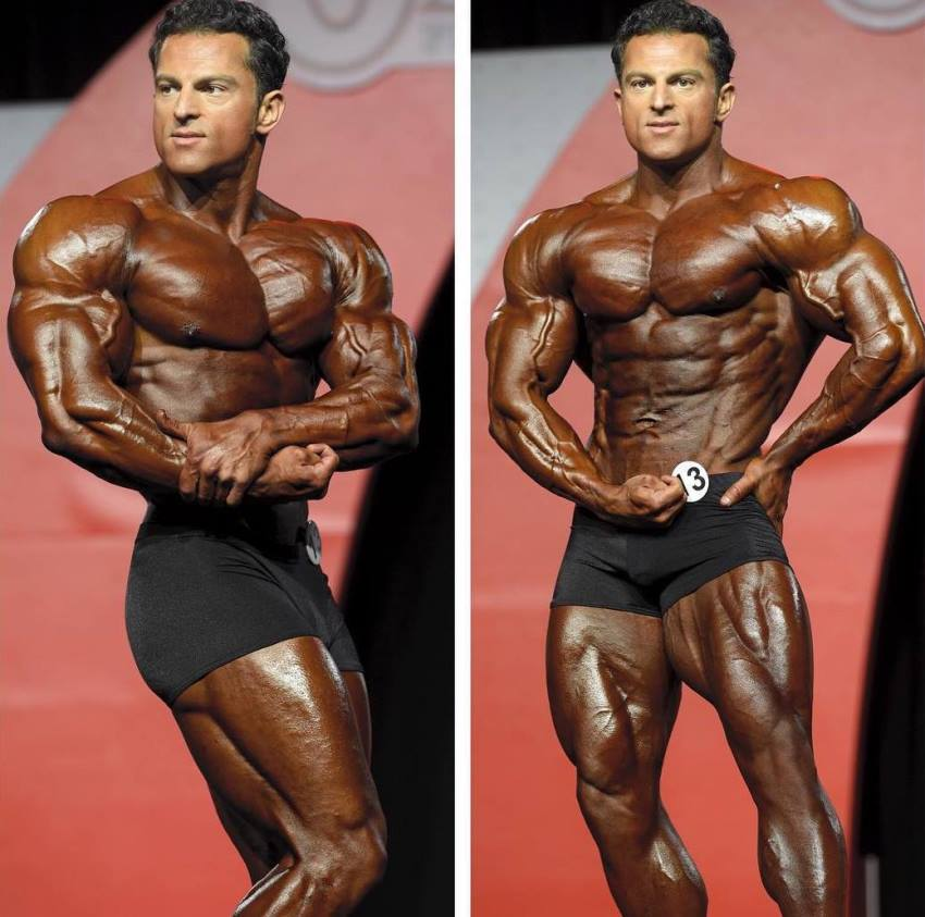 Arash Rahbar in two pictures, standing on the Olympia stage, tanned up, displaying his awesome classic physique to the audience