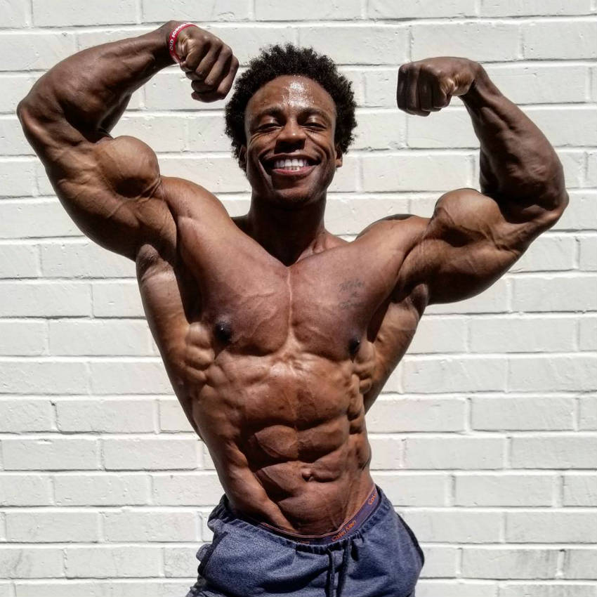 Breon Ansley showing his upper body cut, with his highly visible abs and obliques