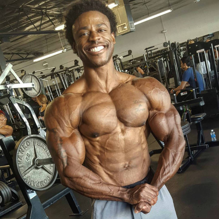 Breon Ansley tensing his chest in the gym while preparing for the 2017 Mr Olympia